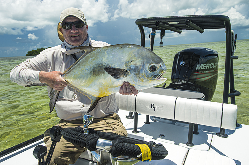 permit following sting ray on the flats